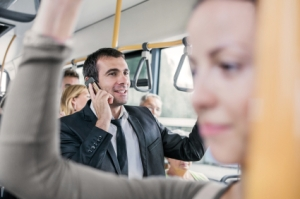 Cheerful mid adult businessman traveling by bus and talking on mobile phone. [url=http://www.istockphoto.com/search/lightbox/9786738][img]http://dl.dropbox.com/u/40117171/group.jpg[/img][/url] [url=http://www.istockphoto.com/search/lightbox/9786622][img]http://dl.dropbox.com/u/40117171/business.jpg[/img][/url]